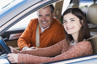 image of dad teaching daughter to drive